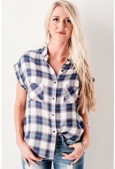Boyfriend Plaid Tee // This cute Boyfriend Plaid Tee has a button-up front with two front pockets, features a shorter front and a longer back. We would pair it with a pair of stressed denim shorts and some cute earrings. // bohme.com