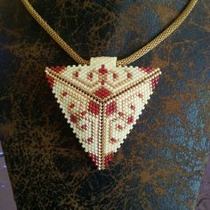 Depending on the size and the design of the locket it can dress up a casual attire of denims or a sweater or it can be the finishing touch to a classy gown. Peyote Patterns, Loom Patterns, Beading Patterns, Seed Bead Jewelry, Bead Jewellery, Beaded Jewelry, Triangle Pattern, Beading Projects, Sequins