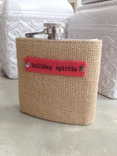 "Fleurty Girl - Everything New Orleans - Holiday Spirits Flask, $20. Stainless steel screw top flask has decorative burlap casing and oh-so-clever ""holiday spirits"" tag."