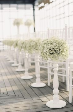 Baby's Breath Aisle Decor except in buckets!