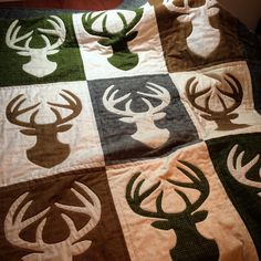 """One of my favorite things about Christmas is making and giving homemade gifts. My husband got a quilt this year. This is made from Woolies Flannel - very soft with the look of wool. The blocks are 14""""x18"""" with a 7"""" border. Deer silhouette is raw edge applique."""