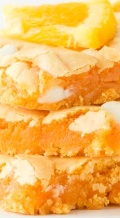 Orange Creamsicle Cake Mix Bars ~ Delicious and bursting with an orange flavor... The white chocolate chips adds the perfect bite of creaminess!