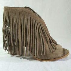 "REDUCED Steve Madden Fringe Shooties Size 7.5! Super cute and chic NEW in box Steve Madden Rock-It Fringe Shooties in color Taupe suede! Paired with a skirt or skinny jeans, these shooties are perfect for a night out in rockin' style with on-trend fringe. ❌TRADES❌MERC ✅PP  Kid suede upper; manmade sole Round peep-toe western shooties Zipper closure at ankle; scallop and fringe details at collar 3-3/4"" block heel Steve Madden Shoes Heels"
