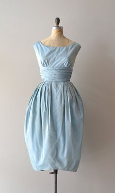 Above the Clouds dress Vintage 1950s baby blue taffeta party dress with wide neckline, deep plunging back with blue velvet bows, cummerbund waist and tulle lined bubble skirt that narrows toward the hem.