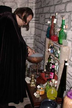 With the exception of the dry ice in the metal cauldron and a couple small jars of plastic flies, ants and spiders, everything was safe to consume. Each bottle had a parchment tag identifying its contents, with the magical contents on one side, and the real contents on the other side of the label. I provided recipe cards for everyone to create their own potion, including name and function, then we all voted on the Best Potion towards the end of the party.