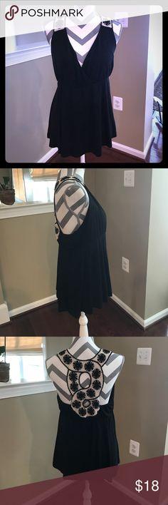 💗NWOT Black tank w/ decorative back. L 💗NWOT Black tank w/ decorative back. L. Very soft, adorable tank, and never worn. VENUS Tops Tank Tops