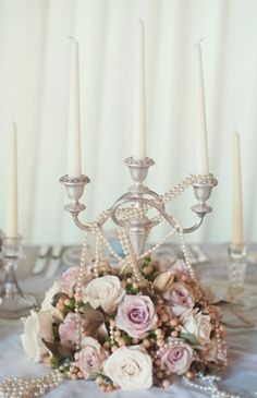 Maybe have a couple of these arrangments on various tables as decorations (guest book, by the bridal portraits, etc). Pearls would be draped a bit neater.