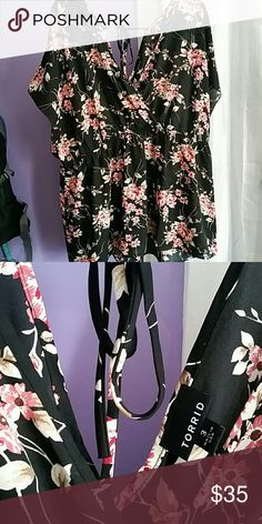 Torrid floral blouse Flowy and elegant black with pink and beige floral double-v baby doll-style top. The back V has a tie; elastic at waist. Size 3 = 22/24 - - only worn twice!! torrid Tops Blouses