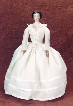 """German Porcelain """"Morning Glory"""" Lady by Lippert. She is wearing a fine early muslin dress and undergarments over a kid body with stitch-jointing and separated fingers. Circa 1855."""