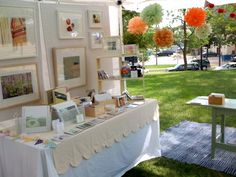 I love the tablecloth!   STELLA + HODGE - Sweet craft booth with pretty tissue paper pom poms