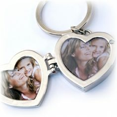 Both fun and functional, our triple #heart #locket key chain carries her keys and photos of her precious ones everywhere she goes!