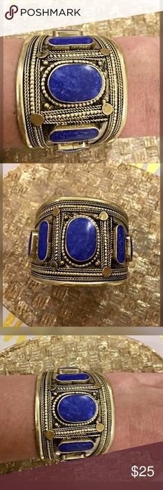 Free People gold tone blue stone cuff bracelet! Beautifully etched gold tone with multiple blue stones! Stunning- never worn! Free People Jewelry Bracelets