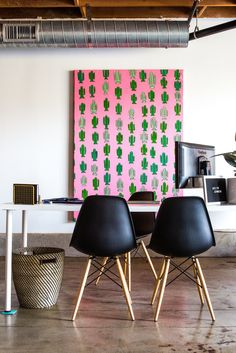 """Oversize canvases add pops of color, breaking up the neutral color palette of the space. Jaclyn commissioned this bright pink and green cactus painting from artist David Kaul. """"I like the idea of repetition and fun prints,"""" she says."""