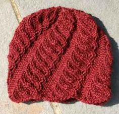 MAPLE SEED by Angela Hahn. A hat that looks good on both men and women. I knit one for my husband and another in the designer's almost-identical-but-more-lacy Beaufort Hat for myself.