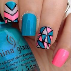 A pink and blue patterned abstract nail art designs. The patterns are divided by thick bold lines of black polish showing how fun and easy going the design is.