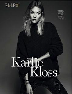 Striking a pose, Karlie Kloss models CH Carolina Herrera jersey sweater and Carolina Herrera pants