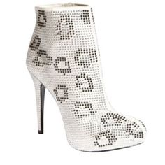 Silver leopard gem zipper booties Worn once. Excellent condition. Silver leopard gem zipper booties. Report Signature Shoes Ankle Boots & Booties