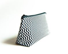 A beautiful cosmetic pouch clutch bag purse handmade by me using a white black zigzag chevron pattern.