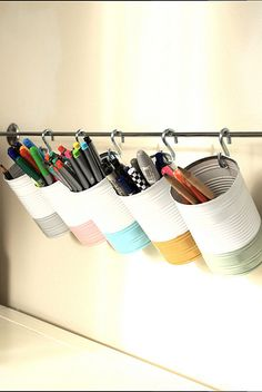 Create simple storage to free up space by re-using cans, S-hooks, & a towel rod #reuse #repurpose