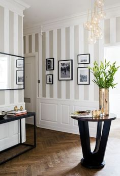 Great combination between colors chosen for striped wall, paneling and dark frames and furniture (room doesn't look dark or crowded)
