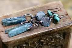 Rustic Primitive Organic Turquoise and Kyanite From by Tribalis; Blue Kyanites, healing stones, have been framed into a copper wire arch and dangle bellow a Indonesian discs in blue Patina and a genuine Turquoise stone wrapped in solid copper wire. Solid copper ear wires as well.$44