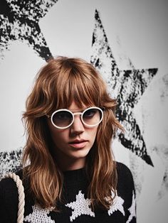 Wearing a hairstyle with bangs, Freja Beha models round sunglasses from Max Mara's spring 2016 collection