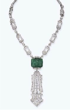 AN ART DECO EMERALD AND DIAMOND NECKLACE, BY RAYMOND C. YARD   Designed as an open-work diamond necklace with diamond collet spacers, also forming a bracelet, suspending a rectangular-shaped carved emerald to the detachable diamond open-work pendant, circa 1925