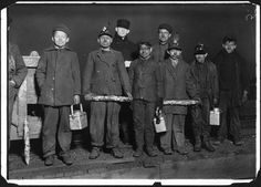 """Shaft #6 Pennsylvania, Coal Co. Clement Tiskie, (smallest boy next to right hand end) is a nipper. Arthur Havard, (on Clement's right hand) is a driver. Jo Puma, (on Arthur's right) is a nipper. Jo's mother showed me the passport which shows Jo to be 14 years old, but he has no school certificate although working inside the mine. Frank Fleming, (boy on left of photo), a nipper. Works a mile underground from the shaft which is 500 ft. down. South Pittston, Pa."""" 1/6/1911"""