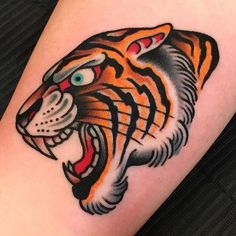 Best Old School Tattoo Ideas. We have a photo gallery featuring cool and meaningful tattoo ideas. And in case you are curious, discover the brief history of tattoo art, as well. Visit our Website for more coll tattoos and everything about tattoos. Tiger Head Tattoo, Tiger Tattoo Design, Head Tattoos, Body Art Tattoos, Sleeve Tattoos, Dragon Tattoos, Arm Tattoo, Traditional Tiger Tattoo, Traditional Tattoo Design