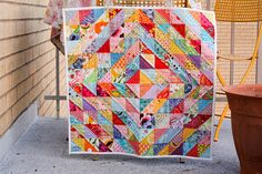 I love half triangle quilts. Great way to use up left over pieces and minimizing the amount you have to purchase.