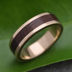 Yellow Gold Lados Nacascolo Wood Ring - ecofriendly wood wedding band, 14k recycled yellow gold and wood wedding ring, mens gold wood ring by naturalezanica on Etsy https://www.etsy.com/listing/241286394/yellow-gold-lados-nacascolo-wood-ring