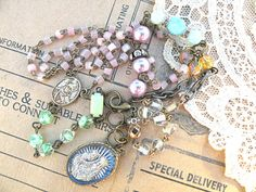 SOLD...religious assemblage necklace medal by lilyofthevally
