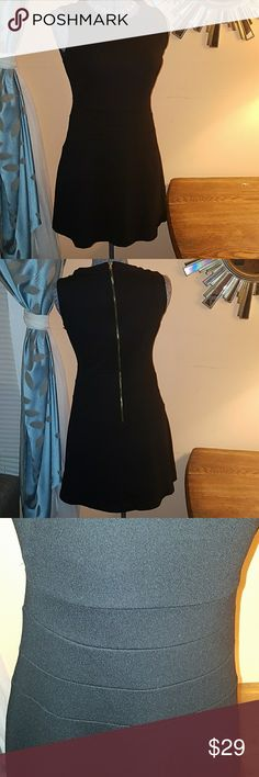 Zara little black dress Very flattering flare dress in excellent condition. No flaws and a shiny gold zipper down the back. Zara Dresses Mini