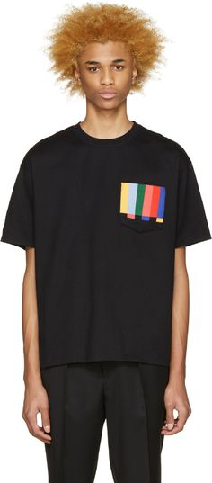 Short sleeve cotton jersey t-shirt in black. Rib knit crewneck collar. Patch pocket at chest featuring multicolor striping. Tonal stitching.