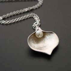Calla Lily Necklace Silver Freshwater Pearl  Love a single pearl on a chain!