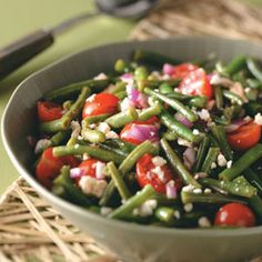 Ingredients        * 2 pounds fresh green beans, trimmed and cut into 1-1/2-inch pieces      * 1/4 cup olive oil      * 3 tablespoons lemon juice      * 3 tablespoons balsamic vinegar      * 1/4 teaspoon salt      * 1/4 teaspoon garlic powder      * 1/4 teaspoon ground mustard      * 1/8 teaspoon pepper      * 1 large red onion, chopped      * 4 cups cherry tomatoes, halved      * 1 cup (4 ounces) crumbled feta cheese