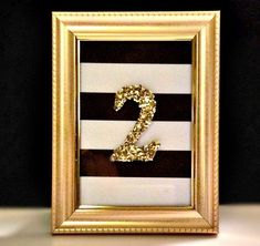 Table Numbers Black and White Stripe with Gold Numbers * Bulk orders receive a discount * When ordering please specify: -Quantity -Color of frame -Sparkle or Matte Gold numbers (or letters) * Frames perfect as gifts after the wedding! * Please feel free to start a convo! I am happy to customize to fit your needs.