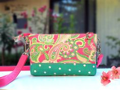 A personal favorite from my Etsy shop https://www.etsy.com/listing/478099085/twin-wallet-pink-paisley-green-bottm