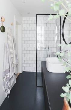 Scandinavian bathroom white tiles and black floor