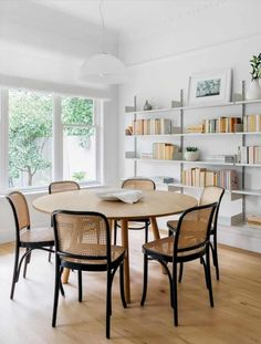 Wicker Dining Room Chairs Wicker Dining Chairs Rattan Dining Chairs Wicker Dining Chairs Neutral Black And White Dining Room Chairs Round Dining Table With Wicker Chairs Cane Back Chairs, Bungalow Interiors, Traditional Interior, Traditional Kitchens, Dining Room Inspiration, Interior Inspiration, Round Dining, Large Round Table, Fine Dining