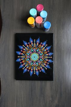 This is an original hand painted dot mandala on wrapped canvas. Decorated with Rhinestones Black base coat Clear top coat to protect the artwork Colorful Thanks for stopping by Dot Art Painting, Mandala Painting, Stone Painting, Mandala Painted Rocks, Mandala Rocks, Mandala Pattern, Mandala Design, Mandala Canvas, Flower Rangoli