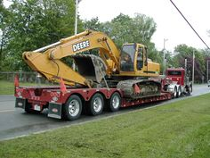 My Hoe and Semi Truck With Low Boy Trailer