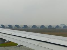 (Tues 3-1-2012) Our Vietnam Airlines flight taxiing before takeoff from Hanoi to Danang, Vietnam. The fog must have caused the late arrival of our flight aircraft.     http://www436.litado.edu.vn/2013/03/20/ve-may-bay-ha-noi-da-nang/  http://www436.litado.edu.vn/category/ve-may-bay-noi-dia/
