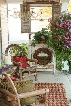 If you are lucky enough to have a front porch, don't forget to decorate it, Pretty example of a cottage style porch.