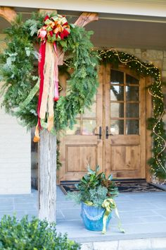 Christmas Front Porch Wreath and Magnolia Leaf Container Arrangement