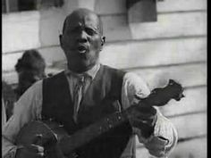 """Uncle John Scruggs from the 1928 movie """"Times Ain't Like they Used to Be"""" doing an old minstrel song """"Little Log Cabin in the Lane.""""  The black banjo tradition had already largely died out by the 20s so this is an exceeding rare glimpse into the past at the earliest form of ragtime."""
