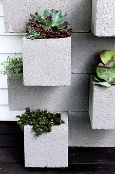 These Do-It-Yourself Cinder Block Planters are a great project for the garden on a budget.
