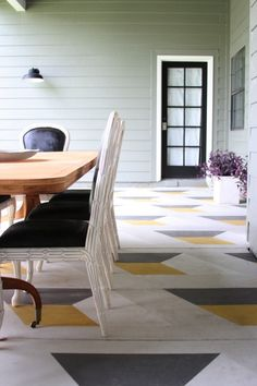 Painting a geometric pattern on a concrete floor. Love this for the area between the deck and the garage!