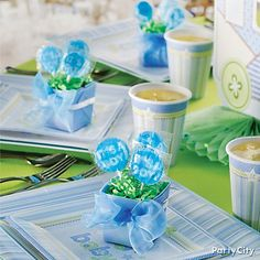 Pre-placing your baby shower favors on place-settings is a good way to make sure each guest receives a favor from your shower.