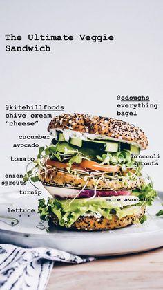 the ultimate veggie sandwich loaded with kite hill cream cheese style spread, sprouts, cucumber, tomato, lettuce, kale pesto, avocado and makes for one delicious gluten-free, vegan lunch #vegan #sandwich